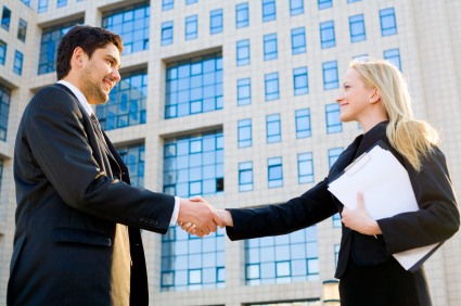 Man and woman shaking hands (business team)